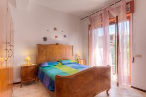 Gemütliches Schlafzimmer der Ferienwohnung in Sizilien am Meer